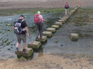Heading across the stepping stones in the Pennard Pill valley
