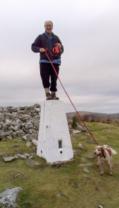 Mike and Pepper on the trig Point at Cribarth
