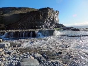 Cwm Nash water crashing onto Traeth Mawr beach