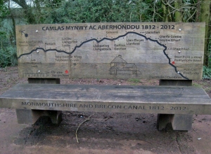 Carved bench showing route of the canal