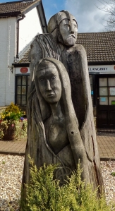 Carving of King Arthur, Guinevere and Merlin