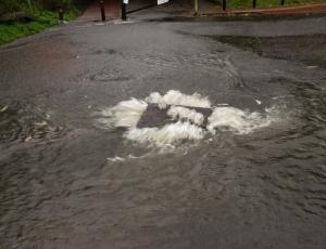 Gushing manhole
