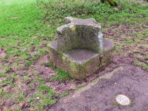 Carved seat at The Dell