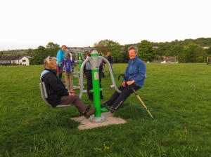 Checking outdoor exercise equipment on common