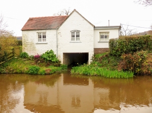 House beside canal with boat garage