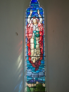 stained glass image of Christ's Ascension into heaven