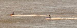 Jet skiers below Penarth cliffs